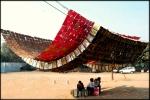 Figure 0.18: Sanjeev Shankar, Jugaad Canopy, 2010, oil cans, public art installation in Rajokri, New Delhi. Courtesy of Studio Sanjeev Shankar. Photograph: Sundeep Bali and Adam Roney.
